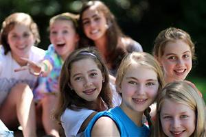girl campers enjoying ice cream at summer camp