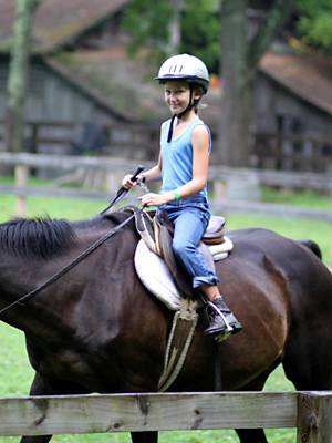 Girl camp equestrian rider