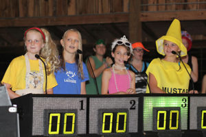 Camp kids playing fun game show