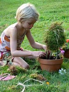 Kids making garden fairy houses