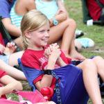 Camper girl giggles at assembly