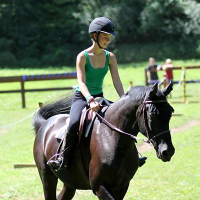 Girl riding a horse in the sun