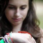 Camper kid holding newt