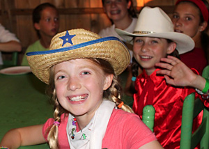 Summer campers dressed in western hats
