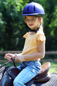 Little Summer Camp girl horseback riding