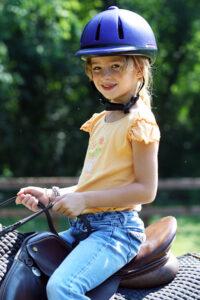 Little Summer Camp girl horseback riding