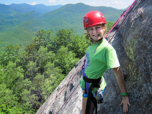 Rockbrook camper Joanna climbing looking glass rock