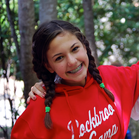 teen girl at summer camp smiling
