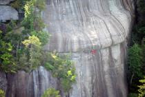 Camper rock climbing Castle Rock North Carolina