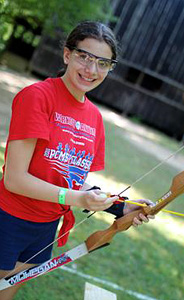 Girls camp archery shooter