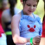 Receiving a swim bracelet after the swim demonstration