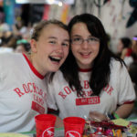 Girls smiling fun at camp banquet