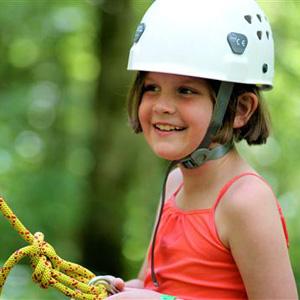 Girl summer camper rock climbing