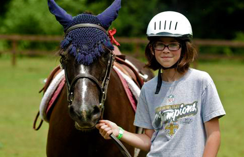 Girl and horse at equestrian camp
