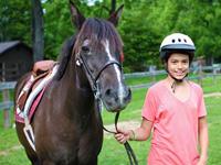 Camper holding horse reins