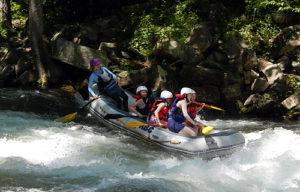Camp girls whitewater rafting on the Nantahala river