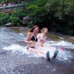 Camp teens slide down water