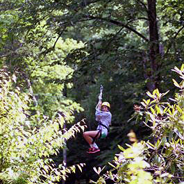 Girl camper riding the Rockbrook Camp zip line
