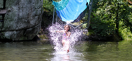 Camp Kid splashing down off the waterslide