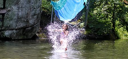 Camp Kid splashing down off the waterslide