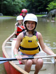 Camp girl lake canoeing