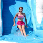 Camper slides down waterslide at carnival