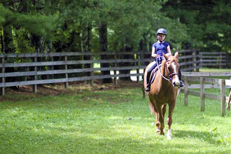 Horseback riding camp girl