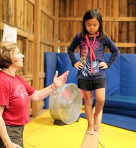 Girl doing gymnastics at summer camp