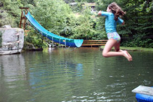 Camper leaps from diving board into the lake