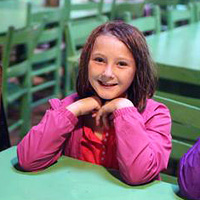 Rainy day at summer camp girl with raincoat