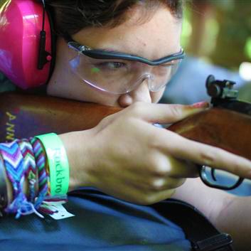 Camp Girl Aiming a Rifle