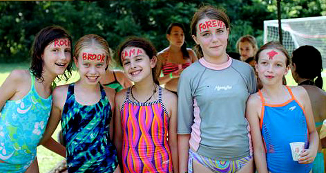 girls with face paint showing they love rockbrook
