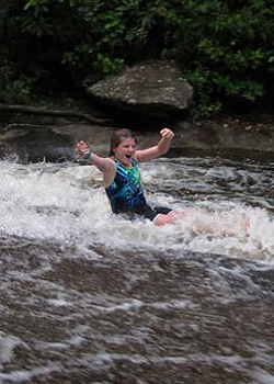 Sliding Rock Girl with hands in the air