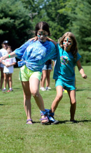 3 legged race for the blue team at camp