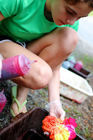 Camp kid tie dyeing t-shirts