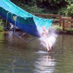 Rockbrook camp water slide splashing kid