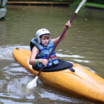 Girl beginner kayaking