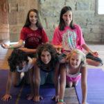 Yoga pose of girls in pyramid