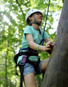 Girl climbing alpine tower