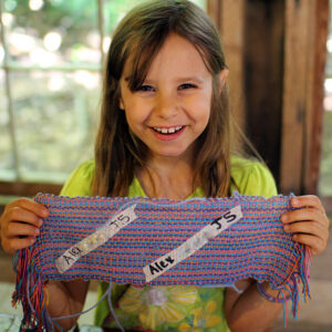 Girl proud of her weaving