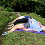 girls cooling their feet while doing yoga