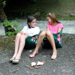 Camp girls chatting in crazy creek chair