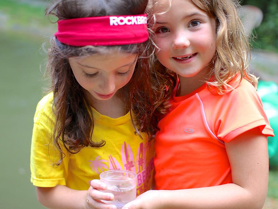 Camp girl find tadpole