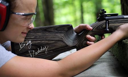 Rifle Marksman girl at camp