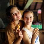 Camp friends eating a fresh muffin