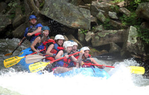 Raft drops over nantahala river rapid