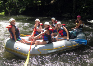 Camp Kids smiling in whitewater raft