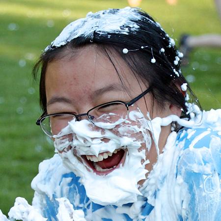 Shaving cream laughing girl