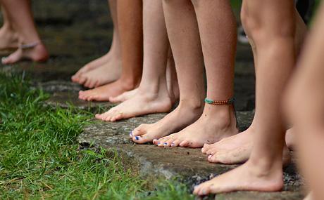 Feet of girls waiting to swim