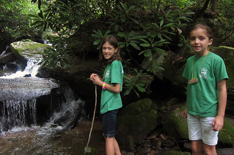 Girls finding a waterfall on hike